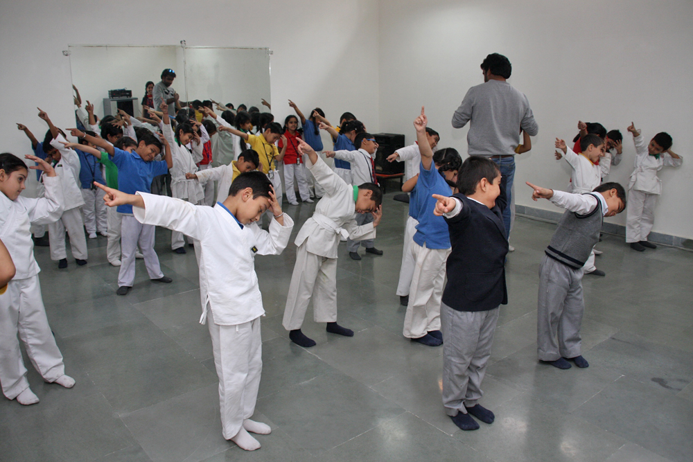 Primary kids learning dance steps