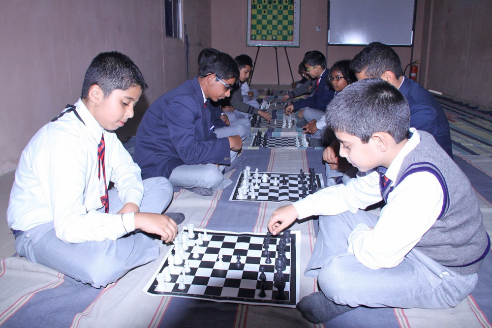 Students learning and practicing various chess strategies