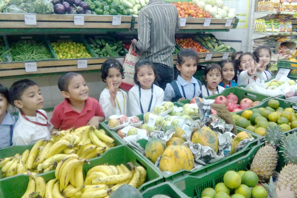 Primary students learning to buy vegetables in SAFAL store