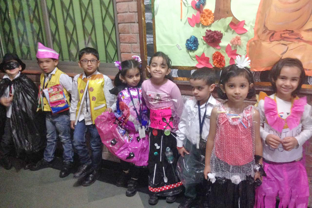 Students posing wearing clothes made from recyled plastics